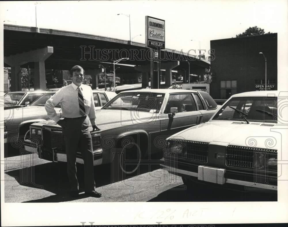 1981 Press Photo John Healey on Cadillac dealership lot in ...