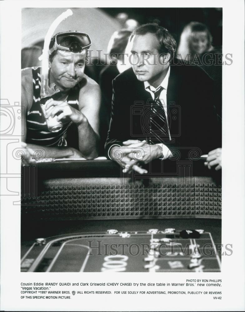"""Chevy Chase And Randy Quaid In Vegas Vacation 1997: 1997 Press Photo Chevy Chase, Randy Quaid """"Vegas Vacation"""