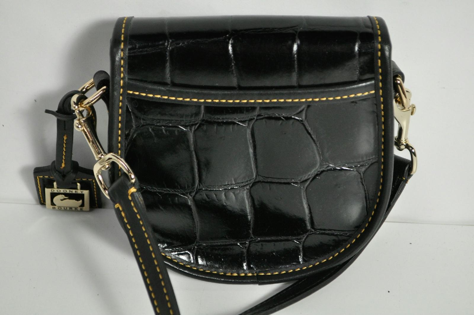 2ec4af318638ed Dooney & Bourke Black Small Button Long Strap Crossbody Bag Purse | eBay