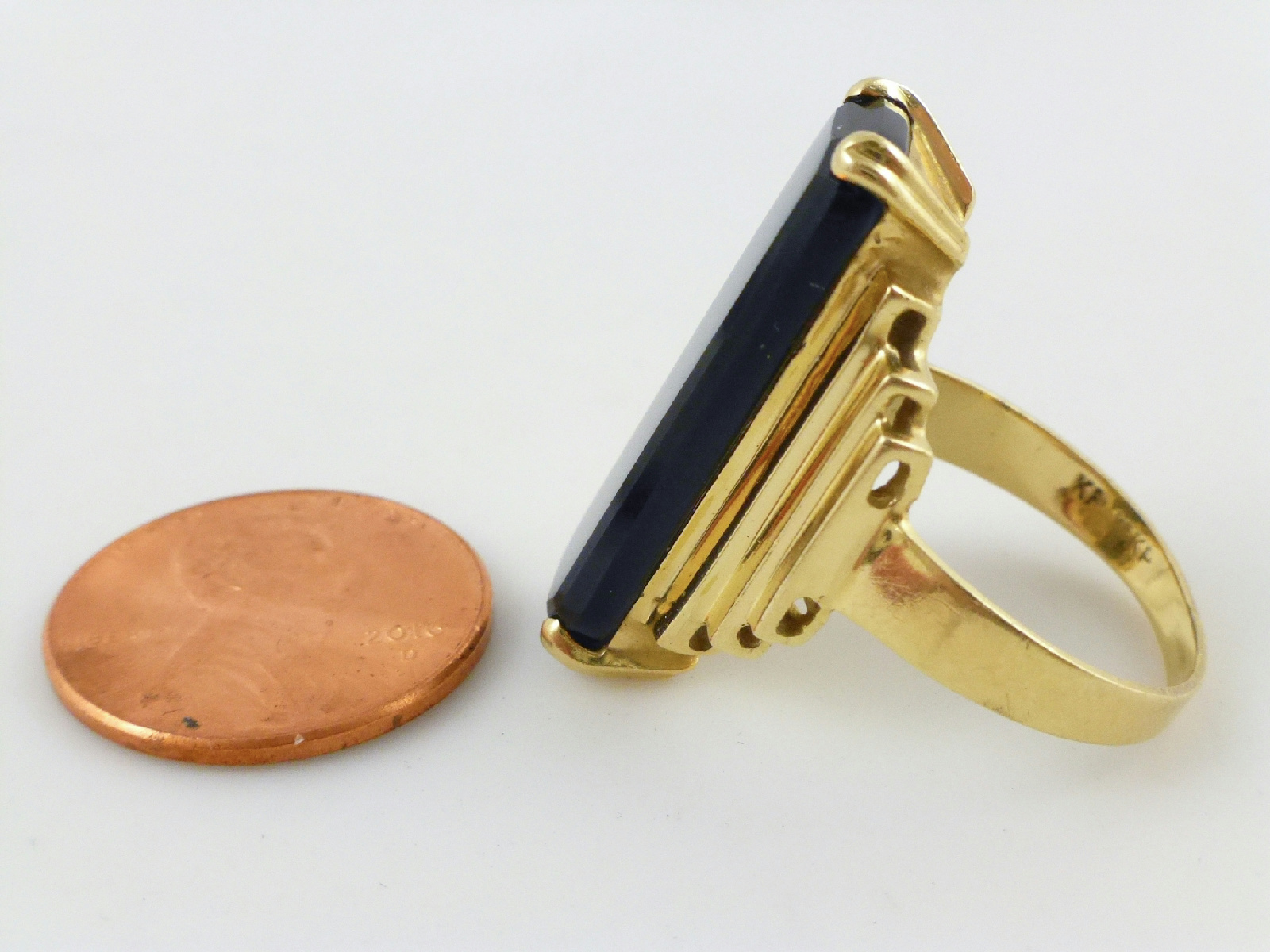 Gold Ring With Black Stone And E X Markings