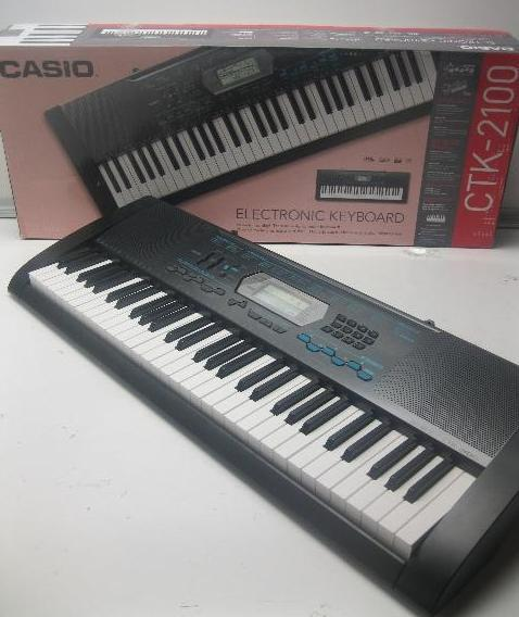 Casio CTK2100 61 Key Portable Keyboard Package Headphones Stand Power