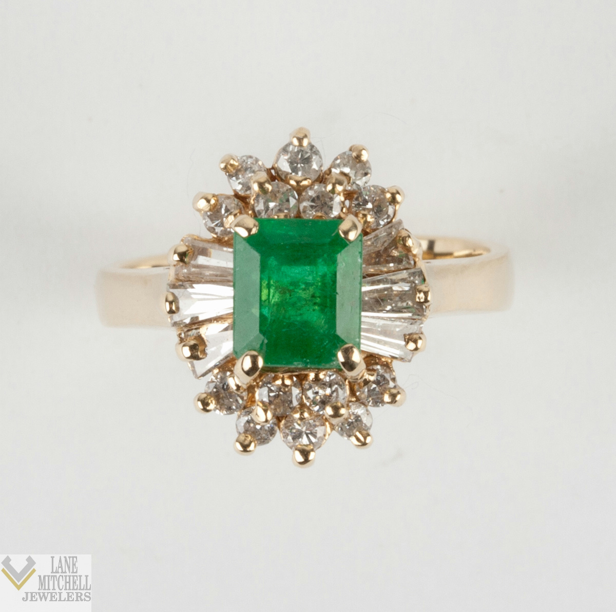 Ladies 14k Yellow Gold Emerald Cut Emerald Solitaire Ring