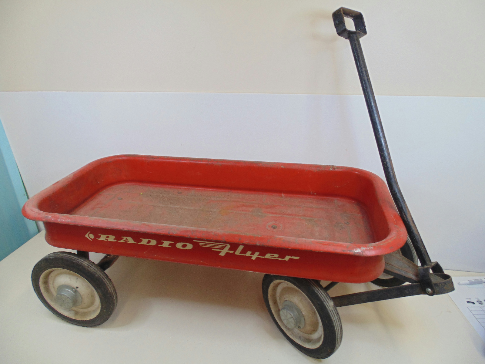 This classic red wagon shows the wear one would expect but is in good ...