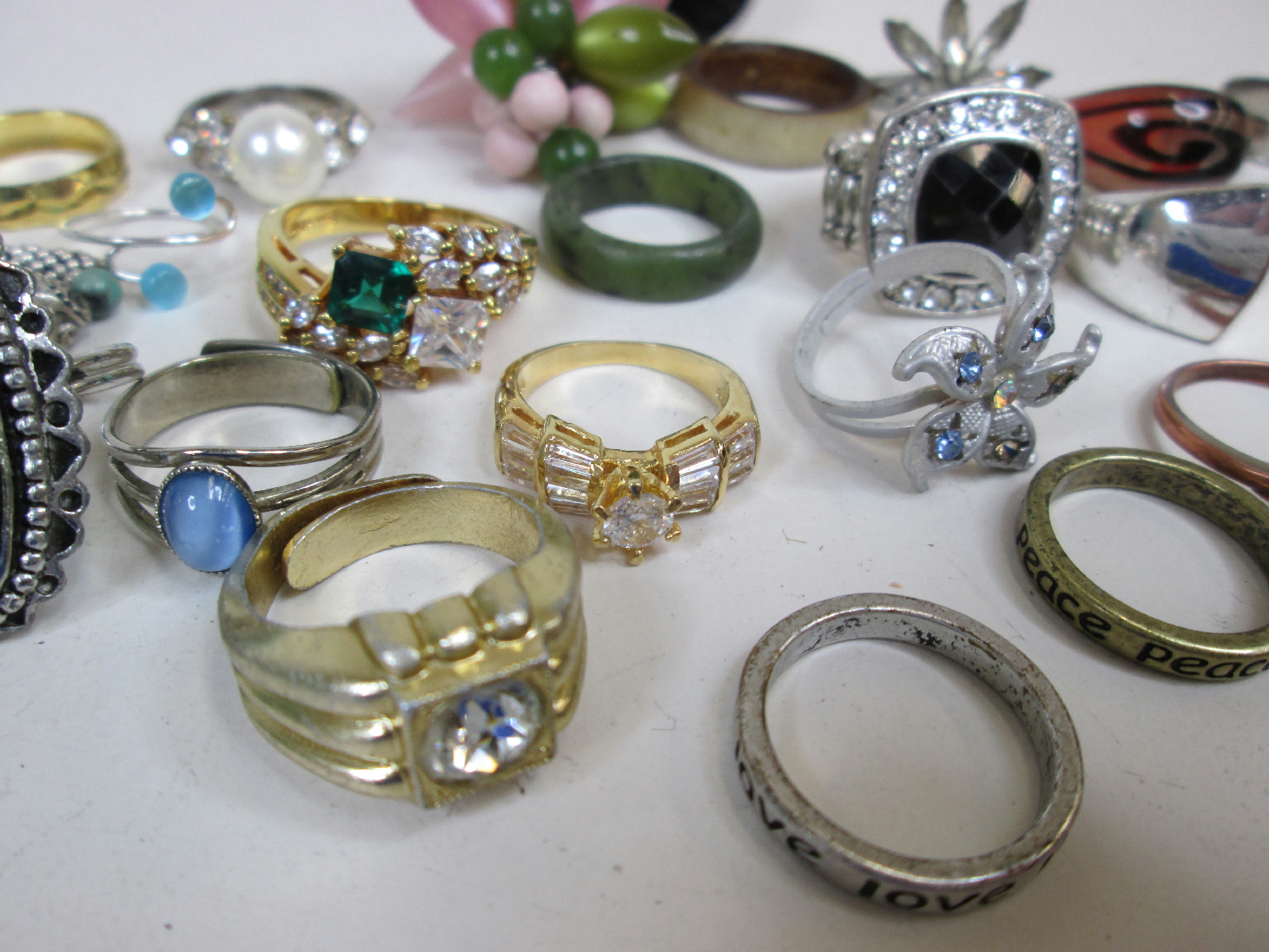 large lot of costume jewelry rings white green blue stones