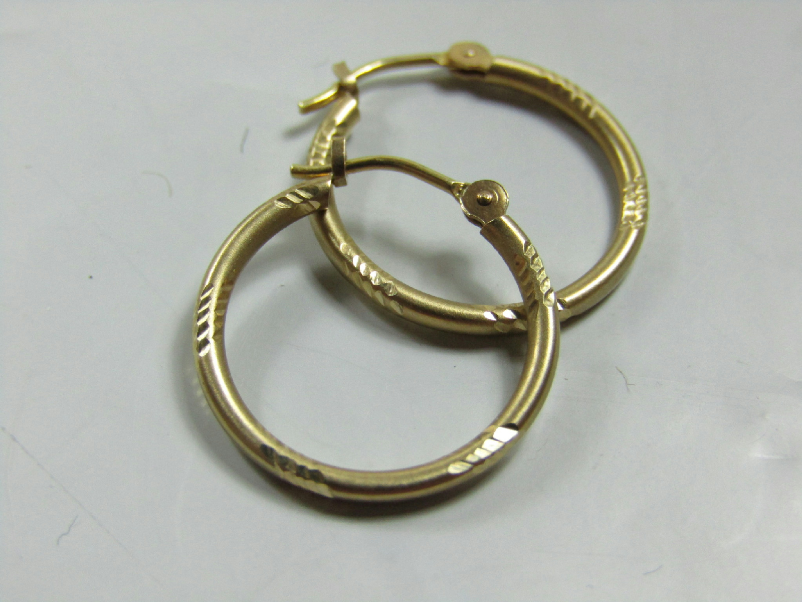 small thin gold hoop earrings 10kt marked yellow gold jewelry etched design small thin 9987