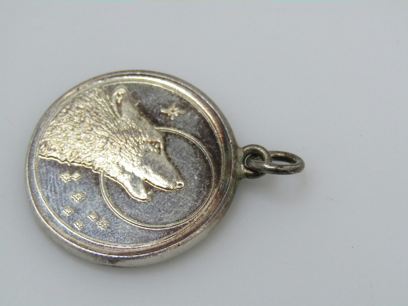 999 silver marked jewelry pendant coin shaped howling