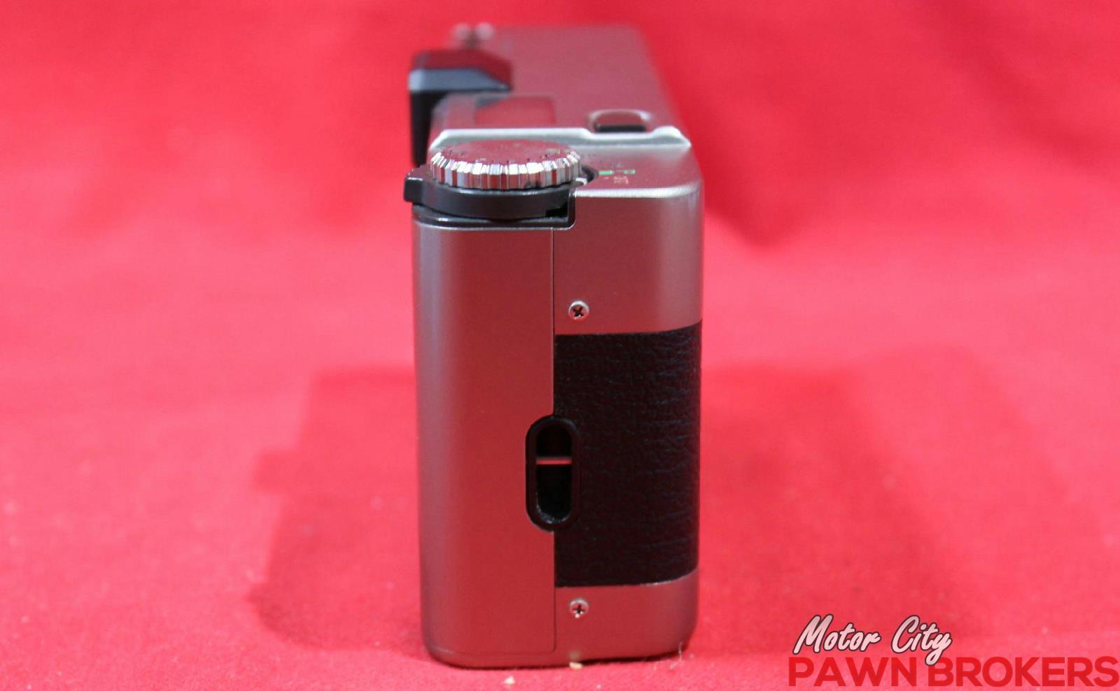 Leica minilux 40mm f 2 4 35mm rangefinder film for Motor city pawn shop