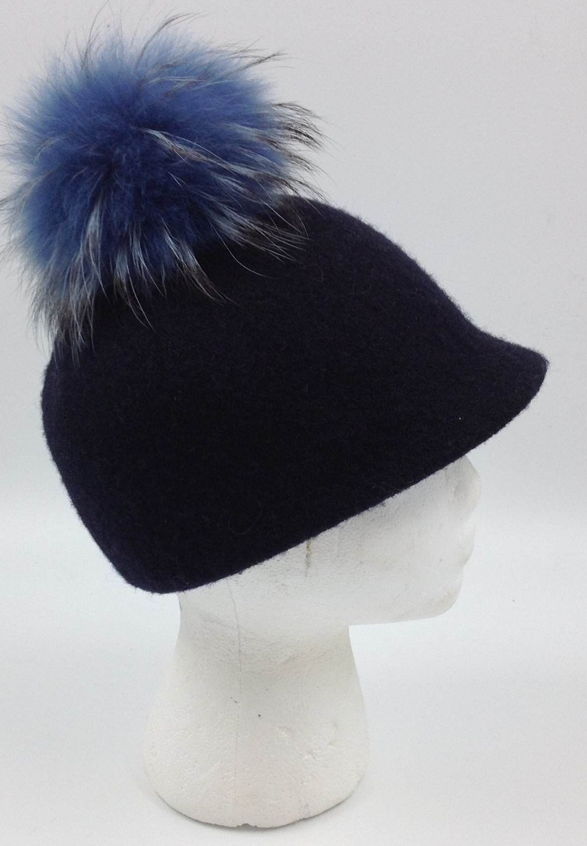This is for a women s Felt Beanie from Complit in Black with two tone blue  ball on top. Item is used but shows little signs of wear. d890d2e2dc