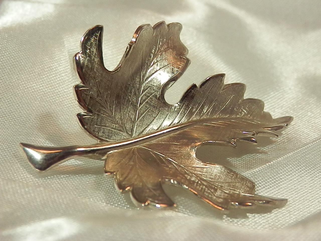 Silver-tone leaf brooch signed Giovann maple leaf